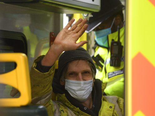Anti-HS2 campaigner Larch Maxey waves from the back of an ambulance (Victoria Jones/PA)