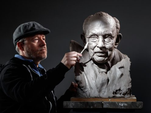 Sculptor Andrian Melka at his studio in York, working on a clay portrait of Captain Sir Tom Moore (Danny Lawson/PA)