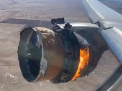 The engine of United Airlines Flight 328 is seen on fire (Chad Schnell via AP)