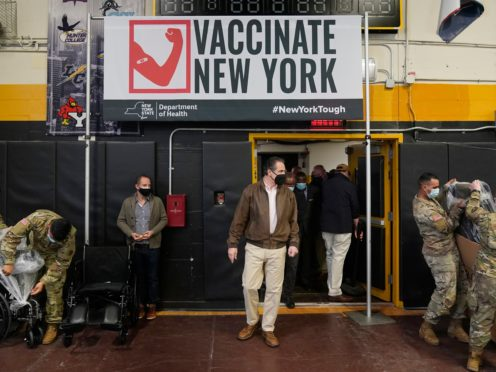 New York Gov Andrew Cuomo arrives at a Covid-19 vaccination site in Brooklyn (Seth Wenig/AP)