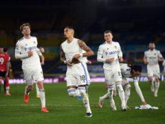 Raphinha (centre) celebrates scoring Leeds' third goal (Gareth Copley/PA)