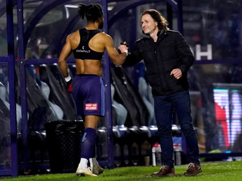 Gareth Ainsworth, right, congratulates Garath McCleary after the game (John Walton/PA)