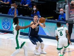 Dallas Mavericks guard Luka Doncic (77) shoots as Boston Celtics forward Aaron Nesmith (26) attempts to defend (Sam Hodde/AP)