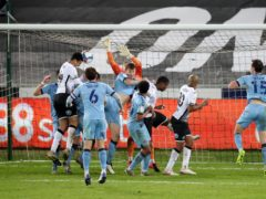Ben Cabango heads home the winner (Nick Potts/PA)