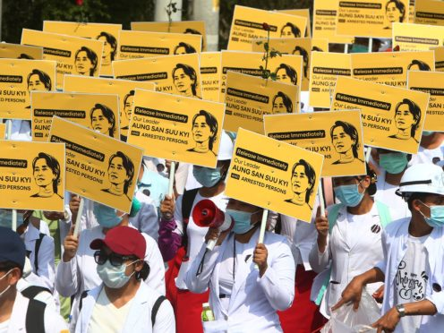 Medical students display images of deposed Myanmar leader Aung San Suu Kyi (AP)