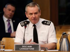 Chief Constable Iain Livingstone insisted there was a 'powerful case' for police officers and staff to be a priority for Covid-19 vaccines (Andrew Cowan/Scottish Parliament/PA)