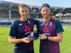 Joe Root (left) receives his 100th Test cap from Ben Stokes (right) (ECB)
