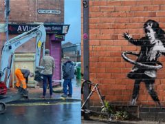 The artwork was removed by workmen early on Wednesday morning (@dangolstein/Twitter and Tim Goode/PA)