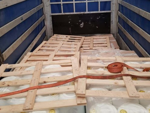 Pallets inside the back of the lorry where the migrants were found. (National Crime Agency/PA)