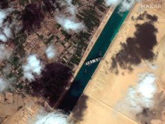 A satellite image shows the cargo ship Ever Given stuck in the Suez Canal in Egypt (Maxar Technologies/AP)