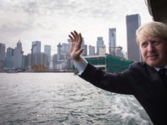 Boris Johnson, then mayor of London, takes the Star Ferry from Hong Kong island to Kowloon (Stefan Rousseau/PA)