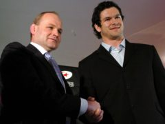 Andy Farrell, right, with England coach Andy Robinson, left, on signing for Saracens (Chris Radburn/PA)