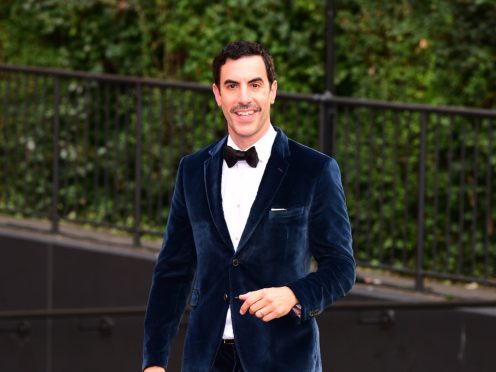 Sacha Baron Cohen revealed his double life as a Covid-19 vaccine dealer to the rich and famous as he starred in a TV sketch (Ian West/PA)