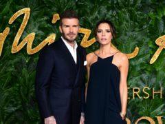 David and Victoria Beckham led the celebrities celebrating International Women's Day (Ian West/PA)