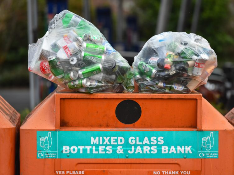 Bags of beer bottles and cans at a recycling centre (Dominic Lipinski/PA)