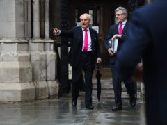 Sir Frederick Barclay (left) leaves the High Court in London, following a preliminary earlier hearing of a money fight his estranged wife Lady Hiroko Barclay (Kirsty O'Connor/PA)