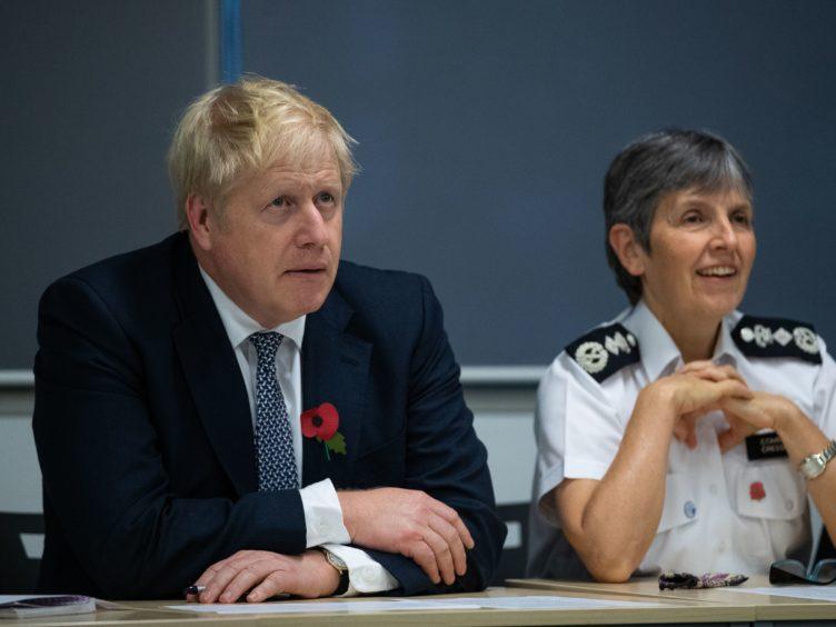 Prime Minister Boris Johnson and Metropolitan Police Commissioner Dame Cressida Dick (Aaron Chown/PA)