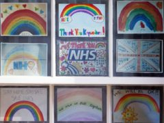 Children's illustrators and writers have created posters calling for a pay rise for NHS staff (Yui Mok/PA)