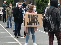 People take part in a Black Lives Matter protest rally in Custom House Square, Belfast, in memory of George Floyd who was killed on May 25 while in police custody in the US city of Minneapolis.