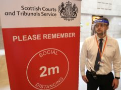 Social distancing measures are currently in place inside courts (Andrew Milligan/PA)