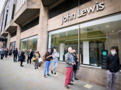 People queue outside the John Lewis department store in Edinburgh (Jane Barlow/PA)