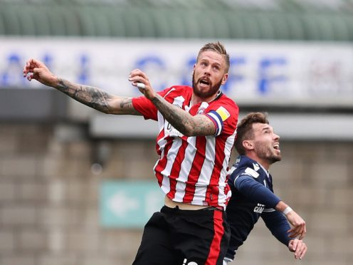 Brentford's Pontus Jansson (left) and Millwall's Tom Bradshaw jump for the ball during the Sky Bet Championship match at The Den, Derby.
