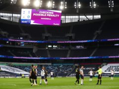 The big screen indicates that the VAR is checking for a possible penalty at Tottenham (Clive Rose/PA)