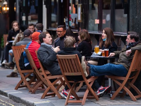 Customers outside a pub in Soho (Dominic Lipinski/PA)