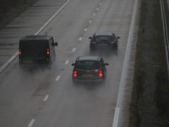 Cars make their way along the M3 motorway near to Popham in Hampshire. Weather warnings have been issued as Storm Barbara is expected to bring gale force winds and heavy showers to southern parts of the UK.