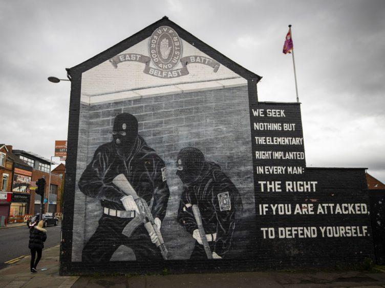 "Ulster Volunteer Force (UVF) mural in support the of Ulster loyalist paramilitary group, on the wall of a property on the Lower Newtownards Road in east Belfast. Paramilitarism remains a ""clear and present danger"" in Northern Ireland, a new report has found. The Independent Reporting Commission (IRC) said it understands from police that there remains thousands of ""signed up"" paramilitary members."