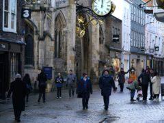 Shoppers walk through the centre of York (Zac Goodwin/PA)