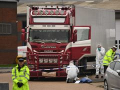 Police in Essex investigate the lorry in which 39 Vietnamese migrants died in 2019. People smugglers will be given life in prison under new proposals under consideration (Stefan Rousseau/PA)