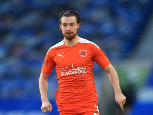 Blackpool's James Husband has missed two games due to a calf problem (Adam Davy/PA)