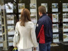 People looking in an estate agent's window. First-time buyers face needing to find nearly £12,000 more for a deposit than they would have done a year or so ago, Halifax said (Tim Ireland/PA)