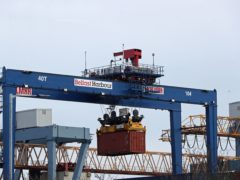 A cargo crate being moved in Belfast Port (PA)