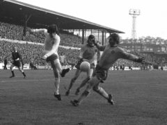 Peter Lorimer (left) in action for Leeds (PA)