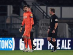 Derby keeper David Marshall leaves the field after picking up a back injury against Nottingham Forest (Mike Egerton/PA)