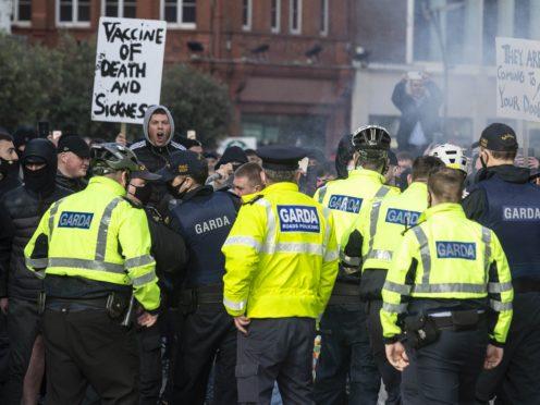 Protestors confront Gardai during an anti-lockdown protest in Dublin city centre.
