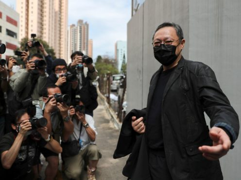 Former law professor Benny Tai, right, is among those facing court (AP Photo)