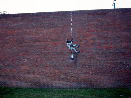 The artwork on the wall of the former prison in Reading, Berkshire (Steve Parsons/PA)
