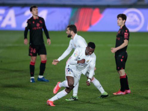 Vinicius Junior (centre) netted a late equaliser for Real Madrid (Bernat Armangue/AP)