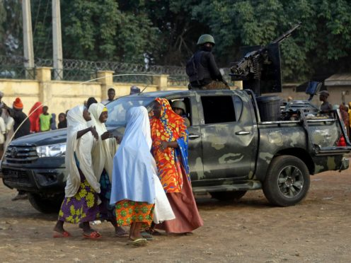 Parents are reunited with their daughters in Jangabe, Nigeria (Sunday Alamba/AP)