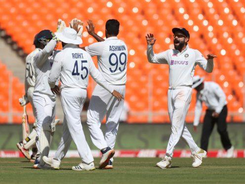 Virat Kohli, right, and teammates celebrate the dismissal of England's Ben Foakes (AP Photo/Aijaz Rahi)