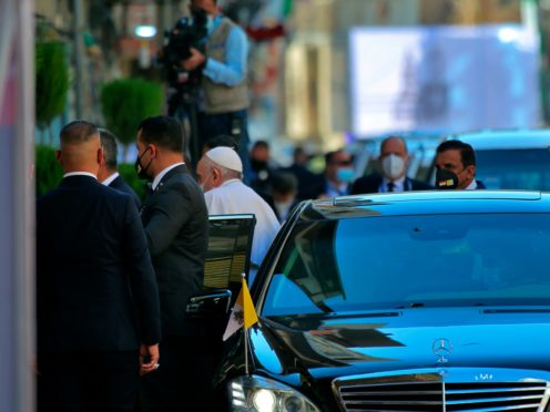 Pope Francis arrives to meet Shiite Muslim leader Grand Ayatollah Ali al-Sistani in Najaf on Saturday (Anmar Khalil/AP)