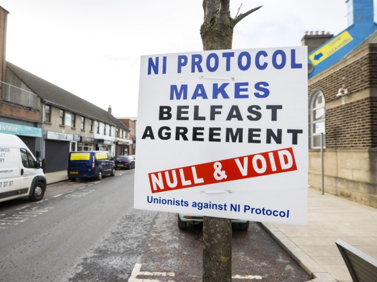A sign by Unionists against the NI Protocol in Larne (Liam McBurney/PA)