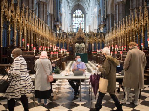 People register for the Covid-19 vaccine at Poets' Corner in Westminster Abbey (Stefan Rousseau/PA)