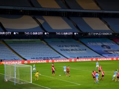 Pep Guardiola is concerned about the quality of the surface at the Etihad Stadium (Gareth Copley/PA)