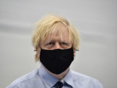 Prime Minister Boris Johnson during a visit to the Lakeland Forum vaccination centre in Enniskillen (Charles McQuillan/PA)