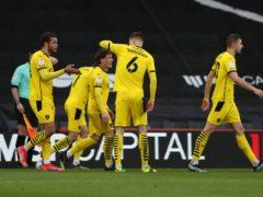 Barnsley players celebrate the winning goal (Kieran Cleeves/PA)