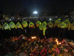 Police at Clapham Common as people gathered in memory of Sarah Everard (Victoria Jones/PA)